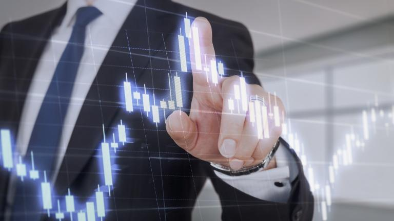 Businessman touching graph