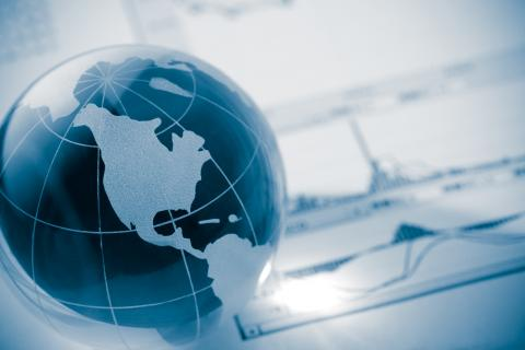 Blue and white illustration of a globe and business concept